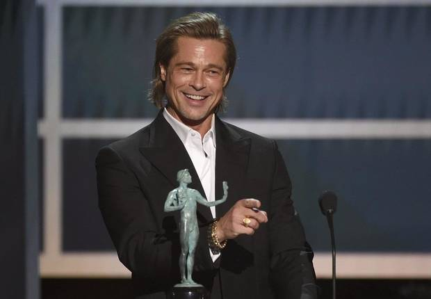 "Brad Pitt accepts the award for outstanding performance by a male actor in a supporting role for ""Once Upon a Time in Hollywood"" at the 26th annual Screen Actors Guild Awards at the Shrine Auditorium & Expo Hall on Sunday, Jan. 19, 2020, in Los Angeles. [AP Photo/Chris Pizzello]"