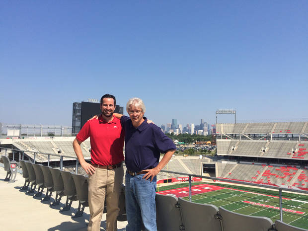 With a view of the Houston skyline in the background, David Bassity and Berry Tramel stand on the top deck of TDECU Stadium. (Photo by Tricia Tramel)