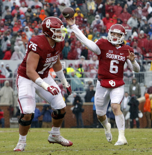 Oklahoma's Baker Mayfield (6) throws a touchdown pass to Joe Mixon (25) during the Bedlam college football game between the Oklahoma Sooners (OU) and the Oklahoma State Cowboys (OSU) at Gaylord Family - Oklahoma Memorial Stadium in Norman, Okla., Saturday, Dec. 3, 2016. Photo by Steve Sisney, The Oklahoman