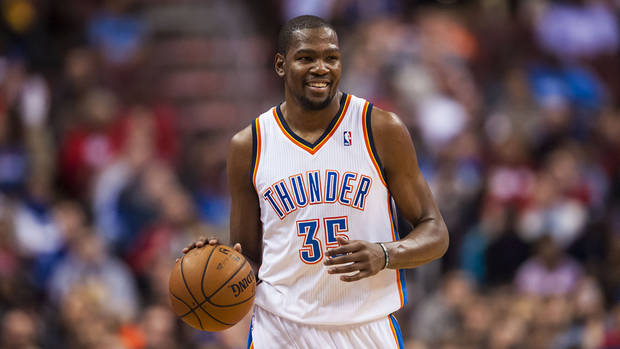 photo - <p>Jan 25, 2014; Philadelphia, PA, USA; Oklahoma City Thunder forward Kevin Durant (35) brings the ball up court during the second quarter against the Philadelphia 76ers at the Wells Fargo Center. Mandatory Credit: Howard Smith-USA TODAY Sports</p>