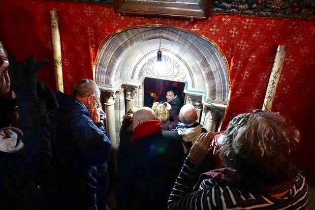 Members of the Oklahoma Religions United Israel tour group prepare to enter the Grotto of the Nativity in the Church of the Nativity in Bethlehem. [Photo by Evan Taylor]