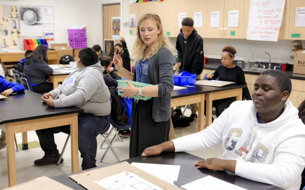 Teacher Katie Guthrie works with her students in art class at Roosevelt Middle School in Oklahoma City, Okla. on Monday, April 16, 2018. Oklahoma City Public School students and teachers returned to class after the two week statewide teacher walkout. Photo by Chris Landsberger, The Oklahoman