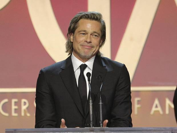 Brad Pitt accepts the David O. Selznick award at the 31st Annual Producers Guild Awards at the Hollywood Palladium on Saturday, January 18, 2020, in Los Angeles. [Photo by John Salangsang/Invision for the Producers Guild of America/AP Images]