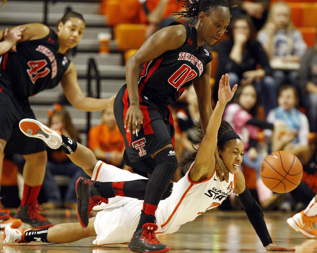 photo - Oklahoma State's Tiffany Bias (3) falls to the court while chasing the ball with Texas Tech's Chynna Brown (00) during a women's college basketball game between Oklahoma State University (OSU) and Texas Tech at Gallagher-Iba Arena in Stillwater, Okla., Wednesday, Jan. 2, 2013. Texas Tech won, 64-59.  Photo by Nate Billings, The Oklahoman