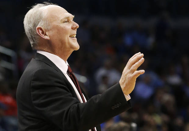 photo - Denver Nuggets head coach George Karl smiles during the fourth quarter of an NBA basketball game against the Oklahoma City Thunder in Oklahoma City, Tuesday, March 19, 2013. Denver won 114-104. (AP Photo/Sue Ogrocki) ORG XMIT: OKSO111