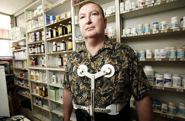 photo - Pharmacist Jerome Ersland talks about a fatal shooting that  occurred at Reliable Discount Pharmacy in Oklahoma City.  Photo by Sarah Phipps, The Oklahoman