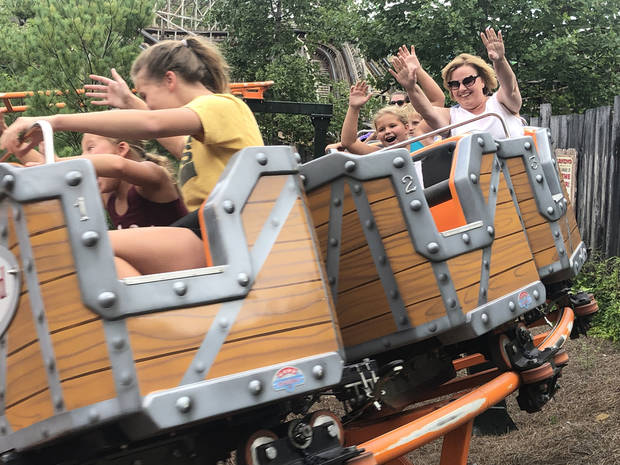 Trish the Dish (right) rides a Dollywood mini-coaster alongside Sadie, with Tinley and Riley in the car in front. (Photo by Berry Tramel)