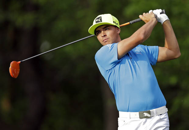 photo - Rickie Fowler watches his tee shot on the 12th hole during the first round of the Wells Fargo Championship golf tournament in Charlotte, N.C., Thursday, May 1, 2014. (AP Photo/Chuck Burton)
