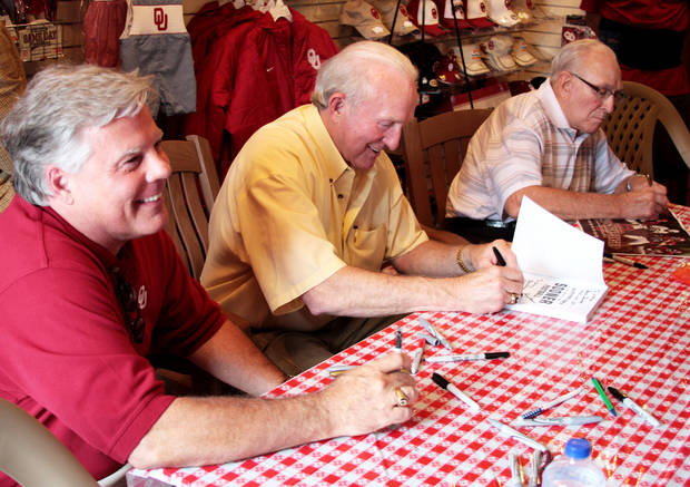 photo - From left, Steve Davis, Jimmy Harris and Claude  Arnold were three of the former OU quarterbacks at Sunday's book signing. Photo provided by Greg Jackson