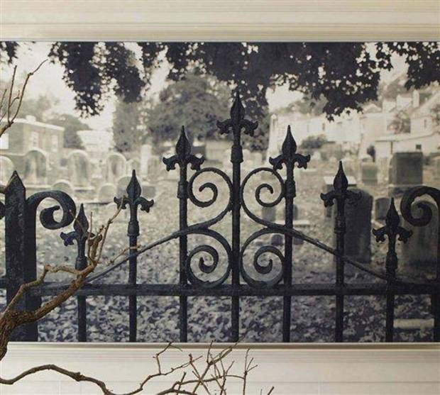 photo - This product image released by Pottery Barn shows their Haunted Gate wall mural featuring a black-and-white photograph of an iron gate opening into a mist-filled graveyard.  This season you'll find lots of ghoulish yet glamorous pieces to decorate with for Halloween.       (AP Photo/Pottery Barn)  NO SALES