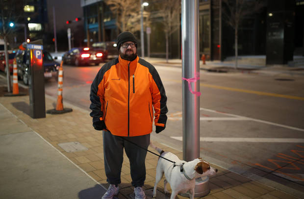 Cody Lusnia mapped non-functioning streetlights in downtown Oklahoma City. [Photo by Sarah Phipps, The Oklahoman]
