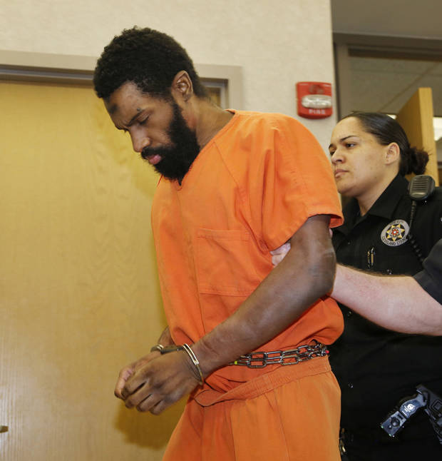 Alton Alexander Nolen leaves the courtroom on April 11 after refusing to respond to his earlier guilty plea in the beheading of Colleen Hufford. Photo by Paul Hellstern, The Oklahoman