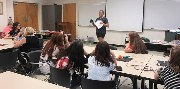 Taelor Brown, Pawnee county 4-H member, leads the crazy sock puppet workshop at State 4-H Roundup. [PHOTO PROVIDED]