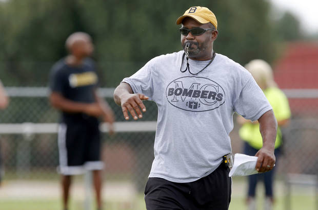photo - HIGH SCHOOL FOOTBALL: Midwest City coach Darrell Hall blows a whistle during football practice at Midwest City High School on Tuesday, August 14, 2013. Photo by Bryan Terry, The Oklahoman