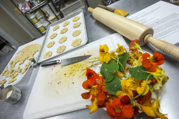 "photo - Greenport chocolatier Miche Bacher, author of ""Cooking with Flowers,"" uses all natural ingredients in her chocolates, cookies and cakes in the Greenport studio. (Randee Daddona/Newsday/MCT)"