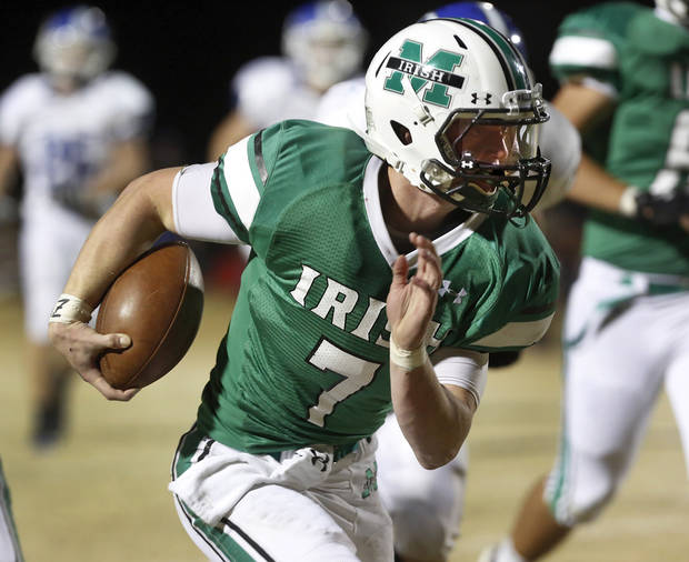 photo - HIGH SCHOOL FOOTBALL: Irish quarterback Jacob Lewis races into the end zone to post McGuinness' first score on this second quarter play. Deer Creek Antlers vs. Bishop McGuinness Fighting Irish at Pribil Stadium Friday night, Nov. 2, 2012.    Photo by Jim Beckel, The Oklahoman