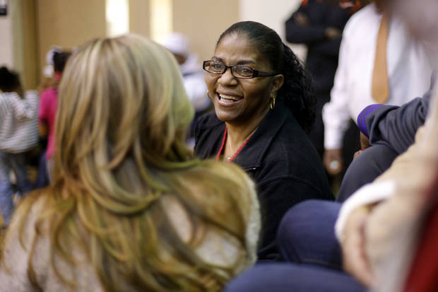 photo - Dorshell Clark talks with friends during her son's, Deondre Clark's, basketball game at Douglass High School in Oklahoma City, Tuesday, January 28, 2014. Photo by Bryan Terry, The Oklahoman