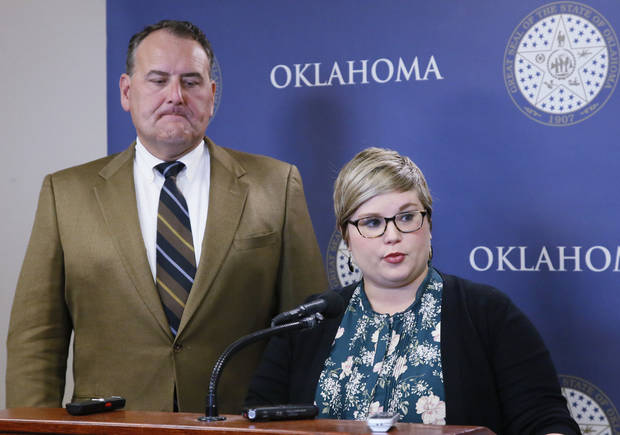 Senate Democratic leader John Sparks, D-Norman, left, and state Rep. Emily Virgin, D-Norman, right, talk with the media at the state Capitol concerning Gov. Mary Fallin and Republican legislative leaders' announcement of a deal to shore up the state budget in Oklahoma City, Monday, Oct. 23, 2017. Virgin and Sparks said there are not enough votes to pass the plan. (AP Photo/Sue Ogrocki)