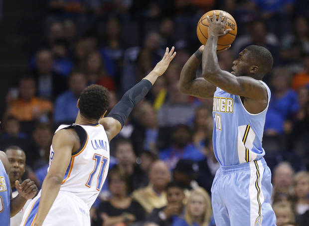 photo - Denver Nuggets guard Nate Robinson (10) shoots over Oklahoma City Thunder guard Jeremy Lamb (11) in the first quarter of a pre-season NBA basketball game in Oklahoma City, Tuesday, Oct. 15, 2013. Oklahoma City won 109-81. (AP Photo/Sue Ogrocki)