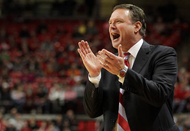 photo - Kansas' Bill Self cheers as his team scores against Texas Tech during an NCAA college basketball game in Lubbock, Texas, Saturday, Jan. 12, 2013. (AP Photo/Lubbock Avalanche-Journal,Stephen Spillman) ORG XMIT: TXLUB105