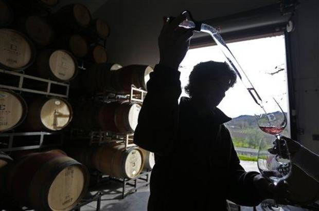 photo - In this photo taken Monday, Jan. 7, 2013, winemaker Kevin Morrisey draws a sample of rose from a barrel at Ehler's Estate in St. Helena, Calif. U.S. wine shipments rose 2 percent last year although foreign wineries captured more of the American wine market, an industry analyst said Wednesday Jan. 30, 2013. (AP Photo/Eric Risberg)