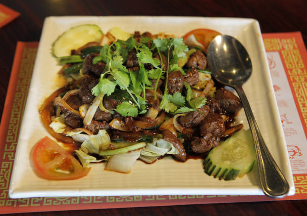 photo - Stir-fried beef tenderloin over steamed rice from Golden Phoenix in Oklahoma City.  Steve Gooch - The Oklahoman