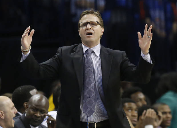 photo - Oklahoma City Thunder head coach Scott Brooks reacts to a call in the third quarter of an NBA basketball game against the Portland Trail Blazers in Oklahoma City, Tuesday, Jan. 21, 2014. Oklahoma City won 105-97. (AP Photo/Sue Ogrocki)