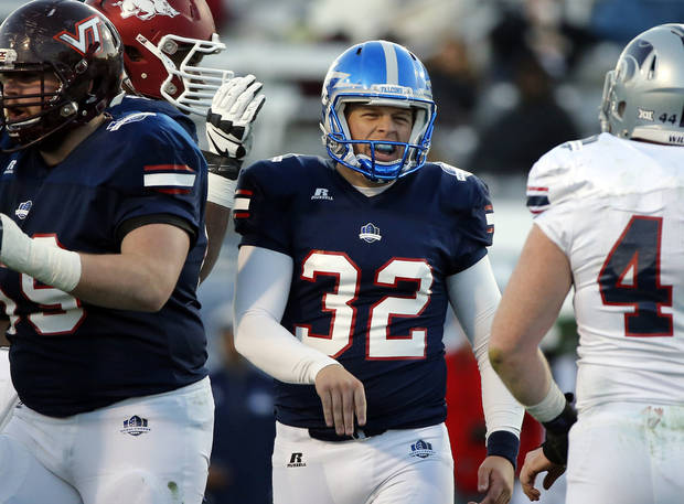 photo - National team place kicker Will Conant (32) celebrates after making a field goal during second half of the Medal of Honor Bowl NCAA football game against the American team, Saturday, Jan. 10, 2015, in Charleston, S.C. The National team beat the American team 26-14. (AP Photo/Stephen B. Morton)