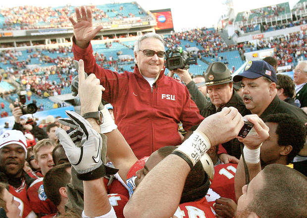 photo - Florida State coach Bobby Bowden is carried on the shoulders of his players Friday after the Seminoles' 33-21 win over West Virginia in the Gator Bowl. AP photo