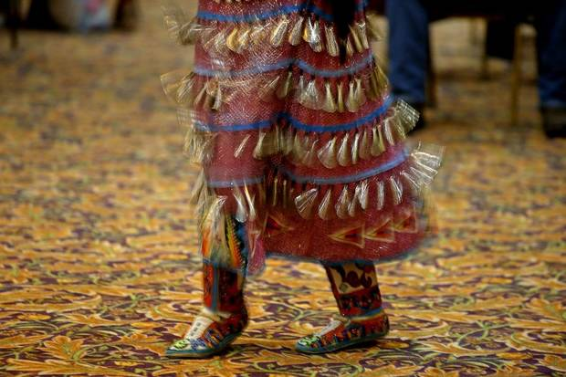 Sophia Thurman, who is Navaho, performs a women's jingle dance dance during a dance exhibition by the Central Plains Dancers at the Red Earth Festival at Grand Event Center at the Grand Casino Hotel & Resort, Saturday, Sept. 5, 2020. [Bryan Terry/The Oklahoman]