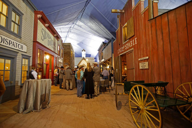 "<p>People gather during a reception for the board of directors of the National Cowboy & Western Heritage Museum on Thursday in ""Prosperity Junction,"" the museum's turn-of-the-century Western town, which Bob Funk and Nedra Funk were primarily responsible for funding in the late 1990s. [Photo by Bryan Terry, The Oklahoman]</p>"