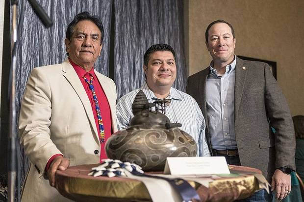 "Caddo Nation citizen Chase Kahwinhut Earles was awarded Best of Show at the 14th annual Cherokee Art Market for his contemporary pottery piece ""Kee-wat: Caddo Home."" From left are Council of the Cherokee Nation Speaker Joe Byrd, Caddo Nation artist Chase Kahwinhut Earles and Cherokee Nation Deputy Principal Chief Bryan Warner. [Photo provided]"