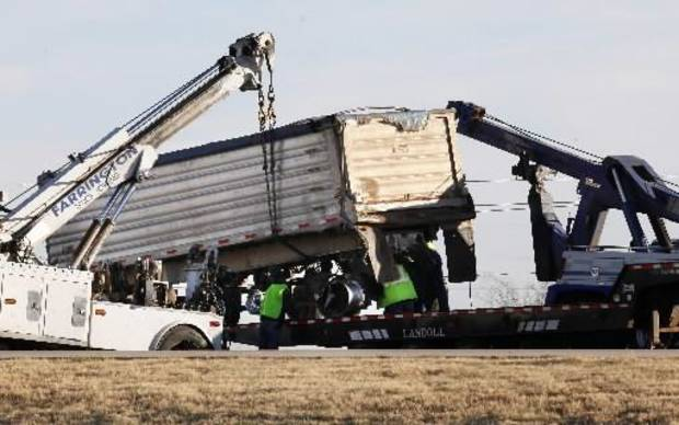 photo - Large wreckers try to lift a semi trailer involved in an accident in the northbound lanes on the John Kilpatrick Turnpike just north of the NW Expressway in Oklahoma City Tuesday, Dec. 4, 2012. Photo by Paul B. Southerland