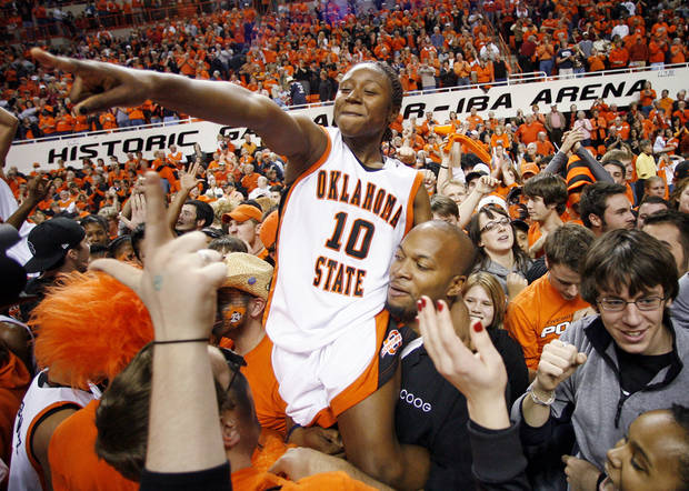 photo - OSU's Andrea Riley (10) celebrates with fans after the women's Bedlam college basketball game between the Oklahoma State Cowgirls and the Oklahoma Sooners at Gallagher-Iba in Stillwater, Okla., Saturday, January 12, 2008. OSU won, 82-63. BY NATE BILLINGS, THE OKLAHOMAN