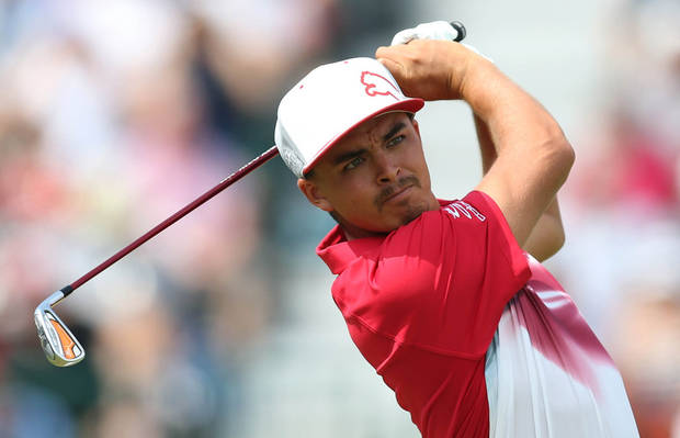 photo - Rickie Fowler of the US plays a shot off the 4th tee during the second day of the British Open Golf championship at the Royal Liverpool golf club, Hoylake, England, Friday July 18, 2014. (AP Photo/Scott Heppell)