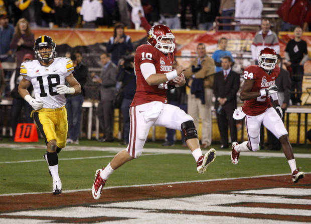 photo - Oklahoma's Blake Bell (10) runs past Iowa's Micah Hyde (18) for a touchdown as Oklahoma's Dejuan Miller (24) watches during the Insight Bowl college football game between the University of Oklahoma (OU) Sooners and the Iowa Hawkeyes at Sun Devil Stadium in Tempe, Ariz., Friday, Dec. 30, 2011. Photo by Bryan Terry, The Oklahoman