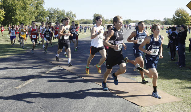 photo - Runners pass an early section during the class 3A boy's State cross country meet at Gordon Cooper Vo-Tech in Shawnee, OK, Saturday, October 20, 2012,  By Paul Hellstern, The Oklahoman