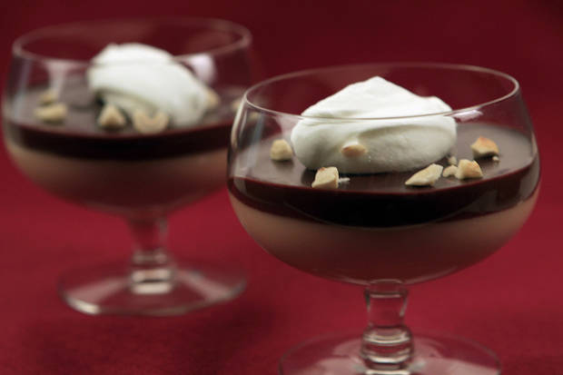 photo - The budino al caramello at Brunos Trattoria in Brea, California, is creamy caramel custard and rich chocolate ganache beautifully layered then topped with a dollop of whipped sour cream and a sprinkling of chopped toasted hazelnuts. (Glenn Koenig/Los Angeles Times/MCT)