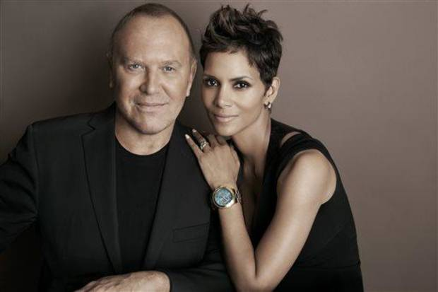 photo - In this April 6, 2013 photo provided by Michael Kors, Kors and actress Halle Berry pose for a photo at Kors' Midtown office in New York. Kors and Berry have announced a partnership with the U.N. World Food Programme to raise money and awareness to tackle the issue of world hunger. (AP Photo)