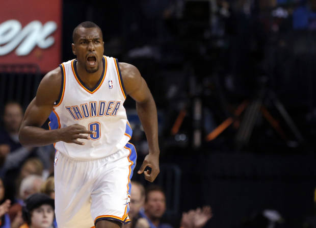 photo - Oklahoma City&#039;s Serge Ibaka (9) reacts to a three-pointer during the NBA game between the Oklahoma City Thunder and the Boston Celtics at the Chesapeake Energy Arena in Oklahoma City, Sunday, March 10, 2013. Photo by Sarah Phipps, The Oklahoman