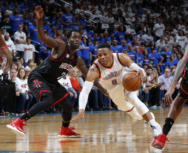 Oklahoma City's Russell Westbrook (0) looks to get by Houston's Patrick Beverley (2) during Game 3 in the first round of the NBA basketball playoffs between the Oklahoma City Thunder and the Houston Rockets at Chesapeake Energy Arena in Oklahoma City, Friday, April 21, 2017.  Photo by Nate Billings, The Oklahoman