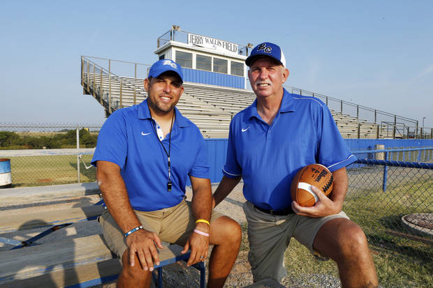 photo - Bridge Creek football coach Greg Wallis with his father Jerry Wallis, who retired as Bridge Creek's coach last year, on Thursday, Sept. 12, 2013 in Bridge Creek, Okla.  Photo by Steve Sisney, The Oklahoman