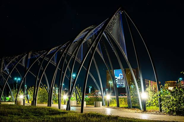 "Enid artist Romy Owens' large-scale public artwork ""Under Her Wing Was the Universe"" is seen at night. [Visit Enid photo]"