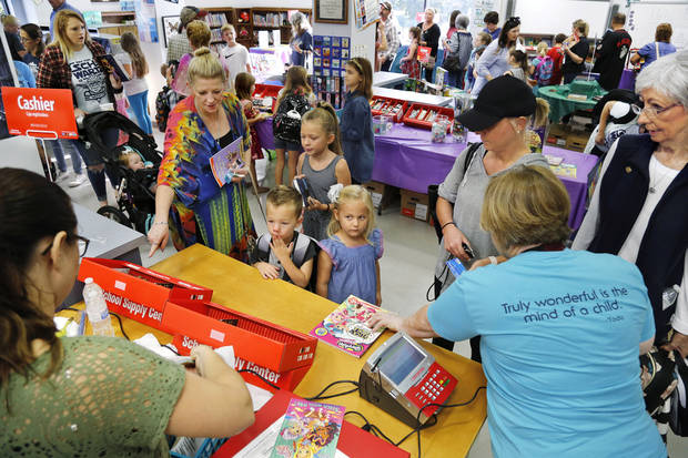 book fair at Schwartz Elementary in the Mid Del district. This is for a story about how schools and parents raise money to cover basic stuff through fundraisers in the era of state budget cuts. Sep. 14, 2018. Photo by Jim Beckel, The Oklahoman
