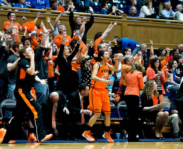 photo - Oklahoma State's bench erupts after a big basket during the first half against Duke University in the women's NCAA Tournament at Cameron Indoor Stadium in Durham, North Carolina, Tuesday, March 26, 2013. (Greg Mintel/Raleigh News & Observer/MCT)