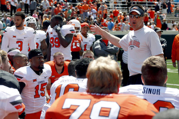 Coach Mike Gundy talks to the Cowboys following the Oklahoma State University Spring football game at Boone Pickens Stadium in Stillwater, Okla., Saturday, April, 18, 2015. Photo by Sarah Phipps, The Oklahoman