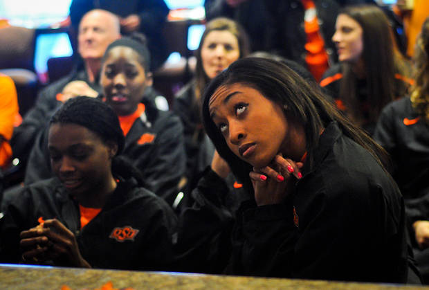 photo - Oklahoma State guard Tiffany Bias watches anxiously while awaiting their seeding in the NCAA tournament at a watch party held at Boone Pickens Stadium in Stillwater, Okla., on March 18, 2013. KT King/For the Tulsa World