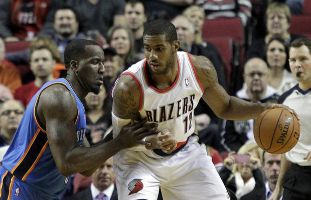 photo - Portland Trail Blazers forward LaMarcus Aldridge, right, backs in on Oklahoma City Thunder center Kendrick Perkins during the first half of an NBA basketball game in Portland, Ore., Wednesday, Dec. 4, 2013. (AP Photo/Don Ryan)