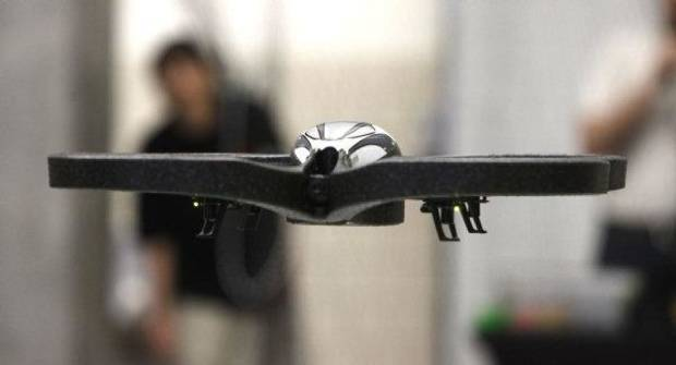 photo - A drone takes to the air as students from middle and high schools compete with flying drones at the University of Oklahoma's Rawls Engeineering Practice Facility in Norman, OK, Saturday, Dec. 3, 2011. By Paul Hellstern, The Oklahoman ORG XMIT: KOD