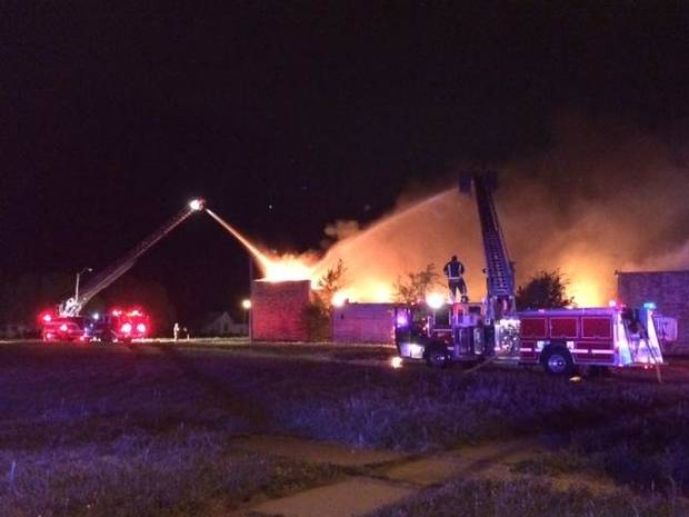 photo -  Above: Firefighters battle a blaze at a former school building in Guthrie early Friday. Photos provided by Guthrie Fire Chief Eric Harlow    -